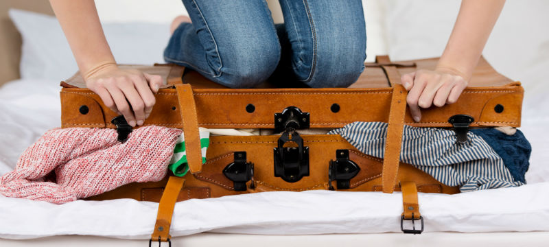 Woman-Packing-Suitcase-800x360